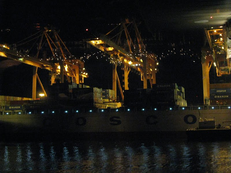 A cargo ship being loaded/unloaded - The Port of Seattle